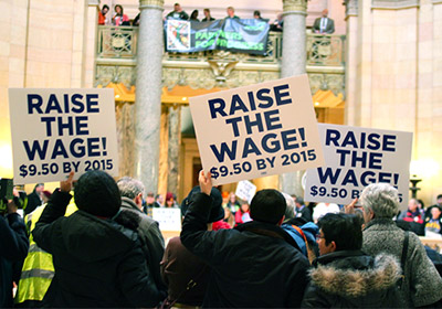 Move To Raise State's Minimum Wage Held Up By Debate Over Indexing