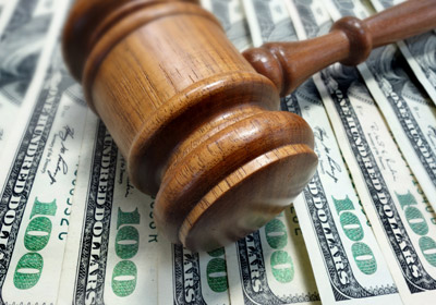 Local Co. Settles Suit For $520K; Criminal Investigation Ongoing