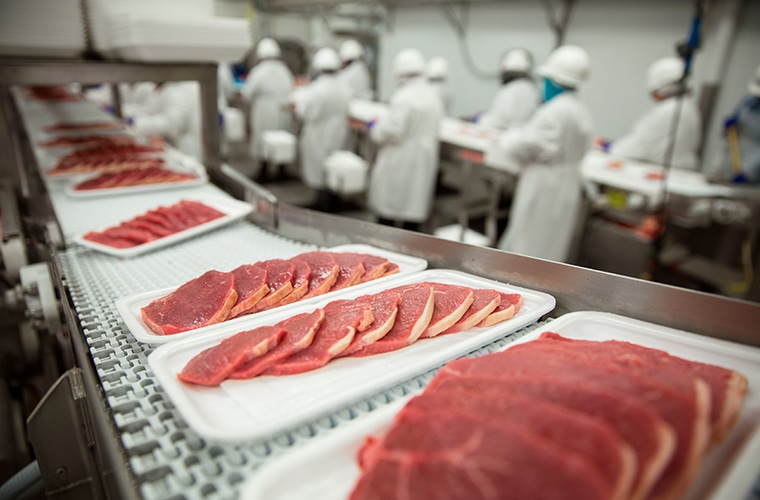 Elbow-to-Elbow Working Conditions in Meatpacking Plants Fuel Spread of Covid-19