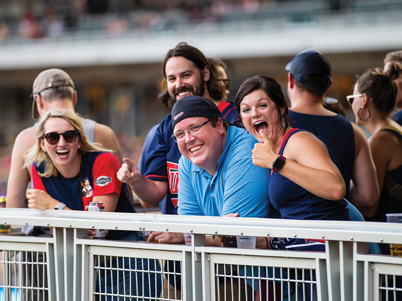Fans at a Twins game enjoying themselves