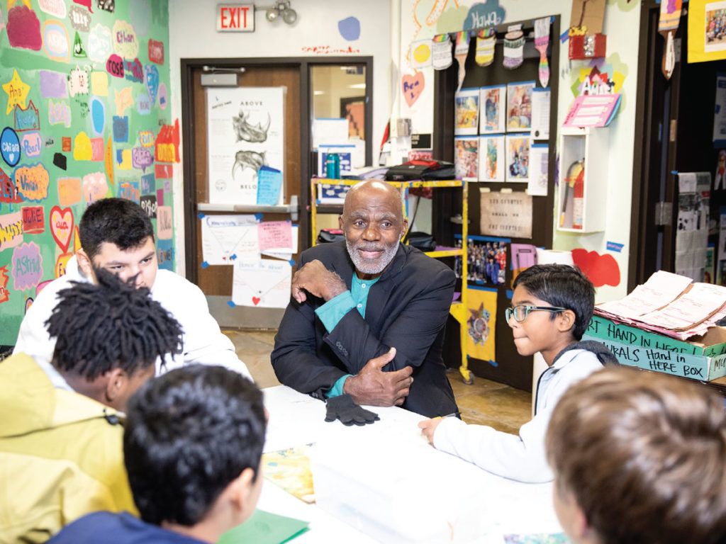 Alan Page talking to school kids