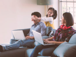 Family of three with laptops