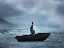 man in a suit in a small boat in a storm