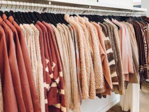 rack of sweaters