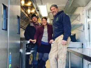 John Hingos, Sara Hingos, and Mark Palm inside Crooked Spoon's new ride.