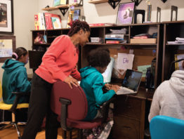 three kids and mom remote schooling