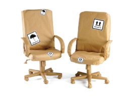chairs wrapped in brown paper