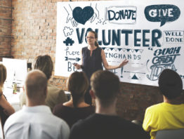 Women leading a volunteer meeting