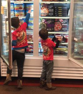 All in the family: Tommy Burt's kids restock shelves.